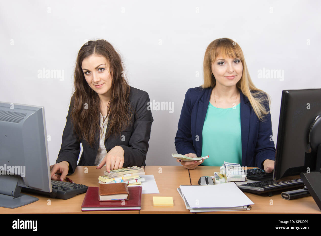 For office desk employee working with money - Stock Image
