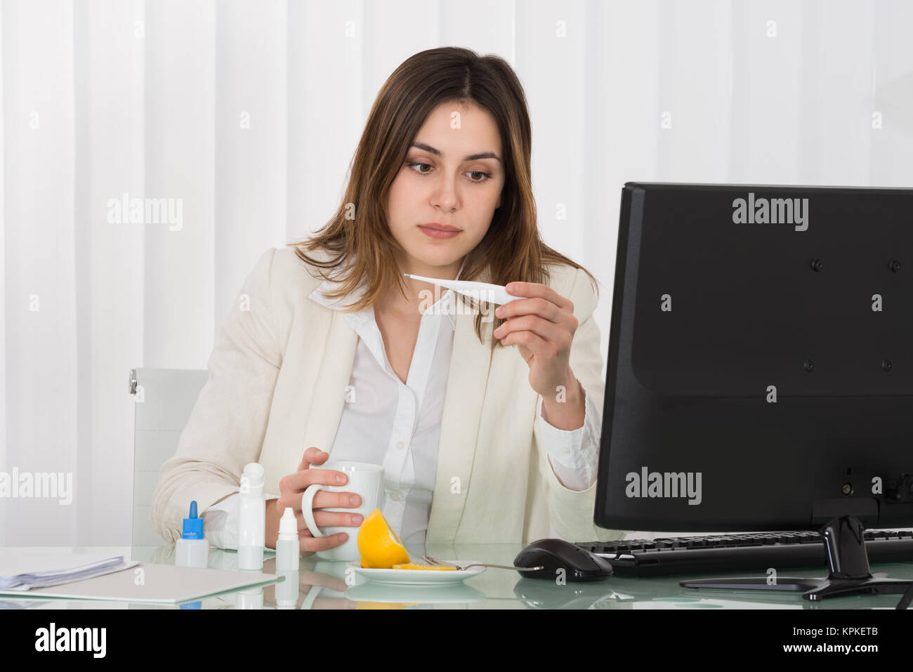 Businesswoman Suffering From Fever - Stock Image