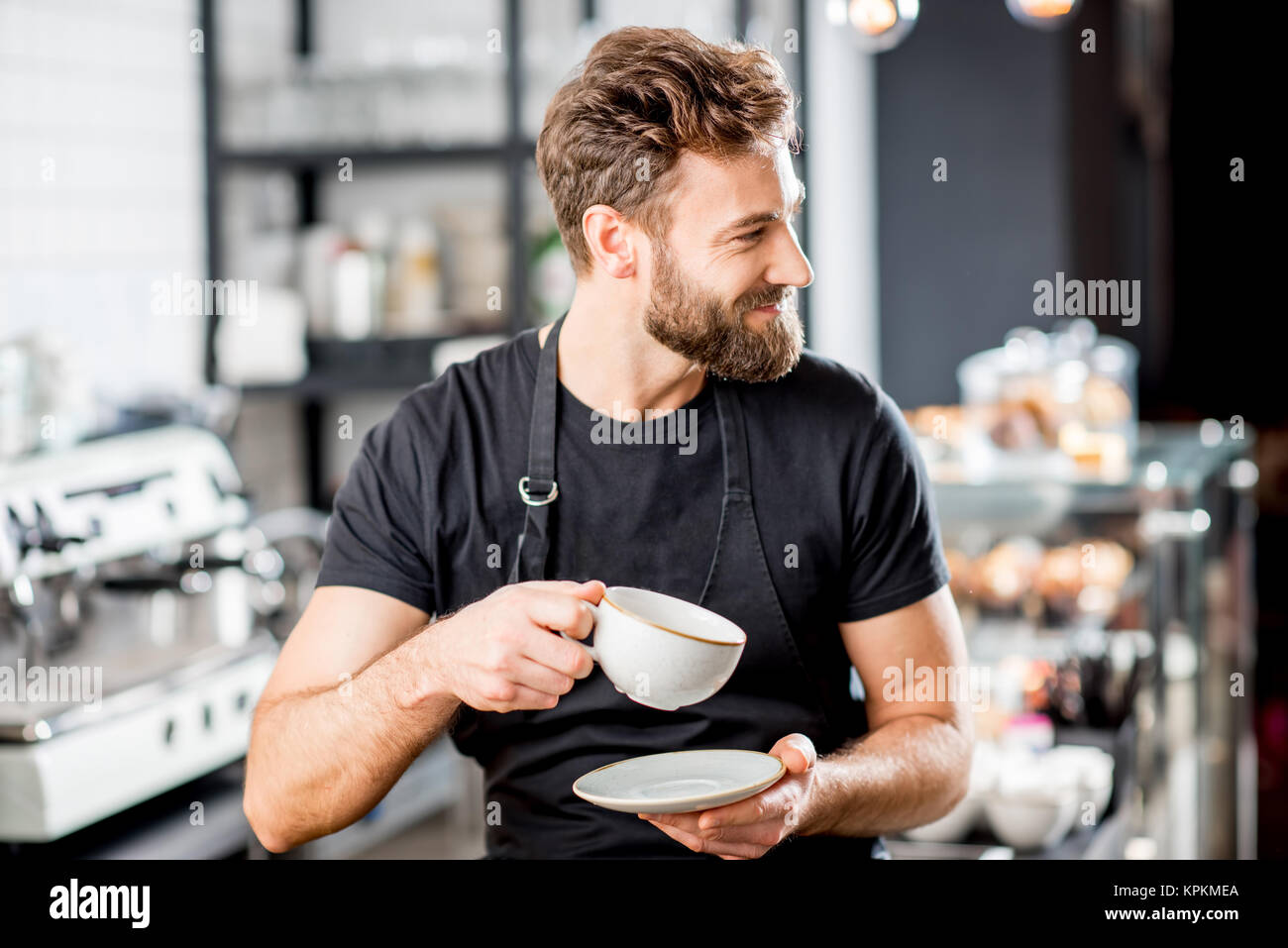 Barista portrait in the cafe - Stock Image