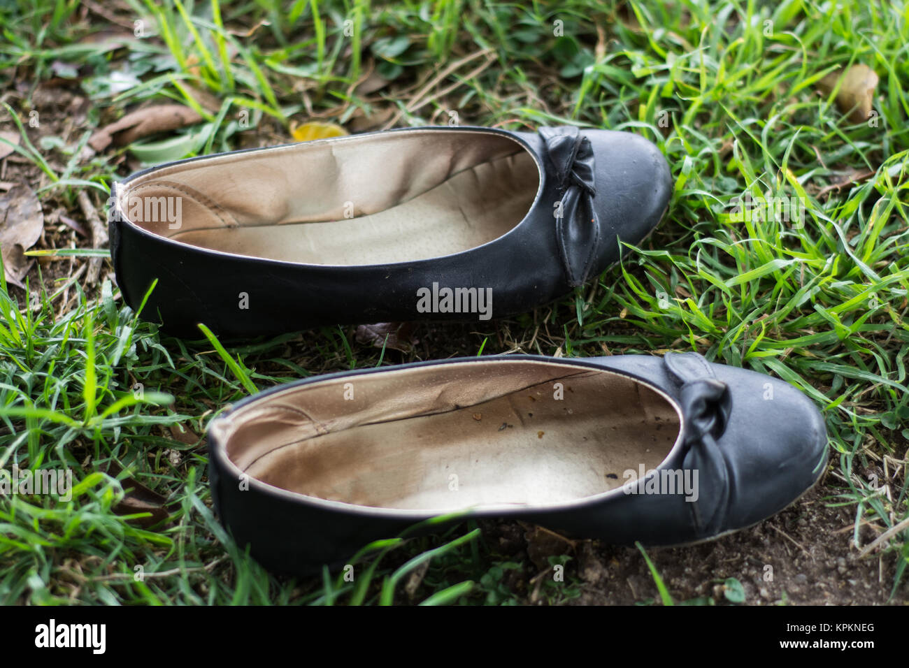 Shoes laying in the grass - Stock Image