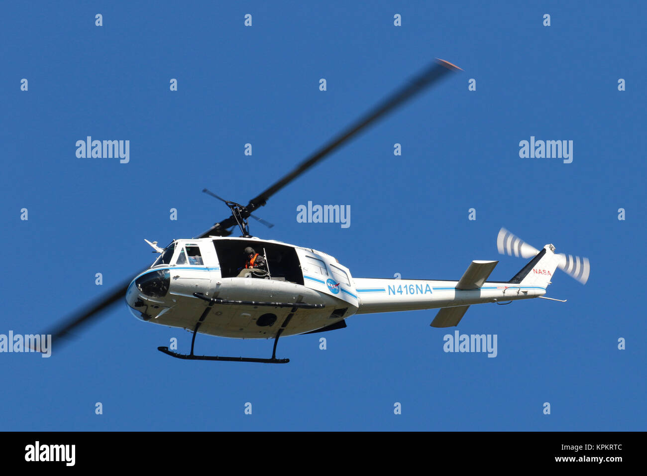 Being watched by the crew of NASA helicopter N416NA at Merritt Island Florida - Stock Image