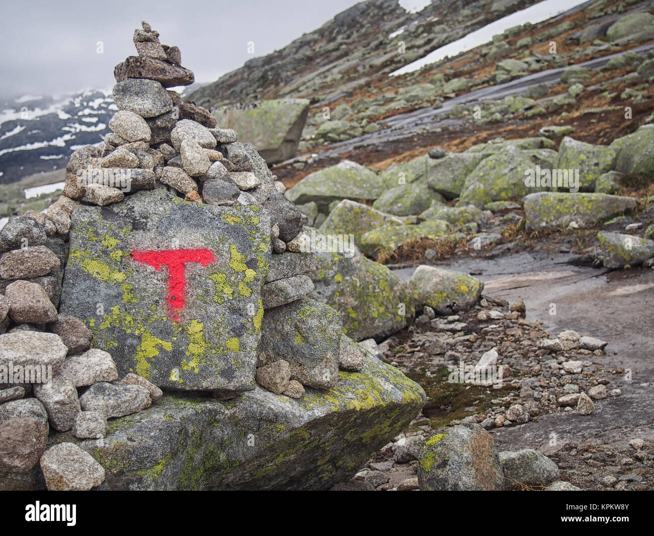 Cairn used as Trolltunga (Troll tongue) trail marker - Stock Image