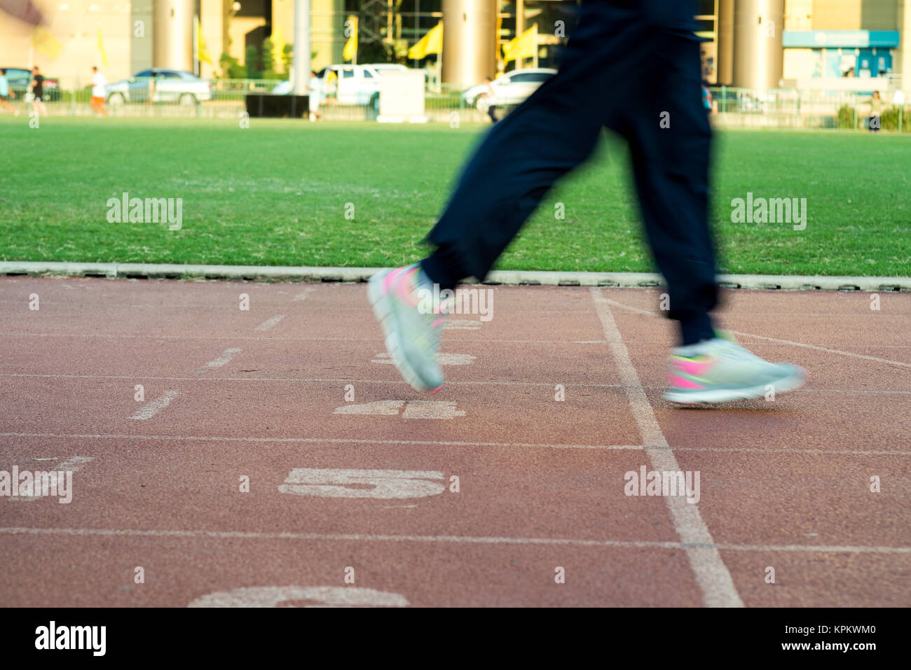Runners feet in motion on track - Stock Image