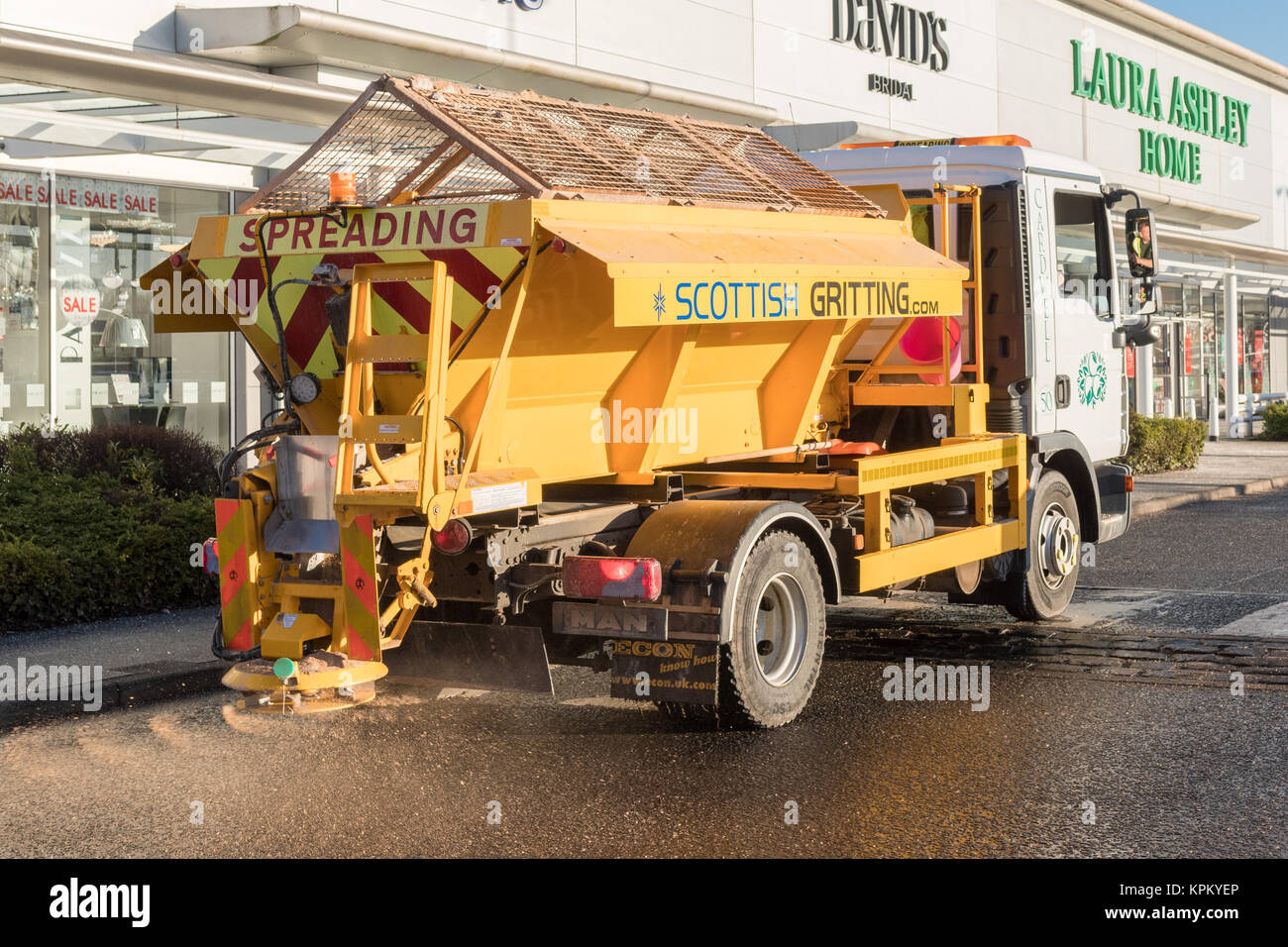 Scottish Gritting private gritting lorry spreading at Breahead shopping centre, Glasgow, Scotland, UK - Stock Image