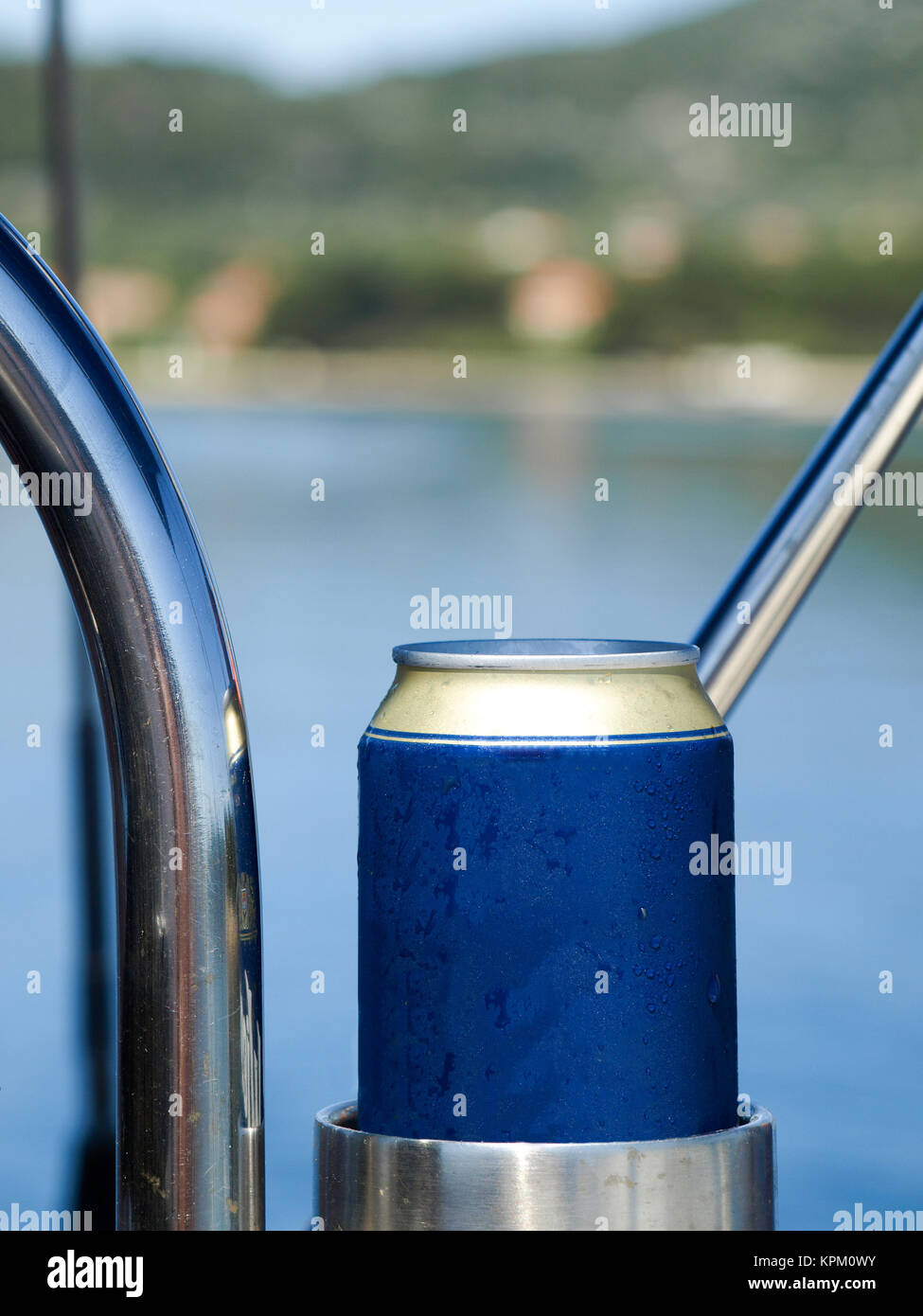 Cold beer in the holder of a sailing yacht Stock Photo