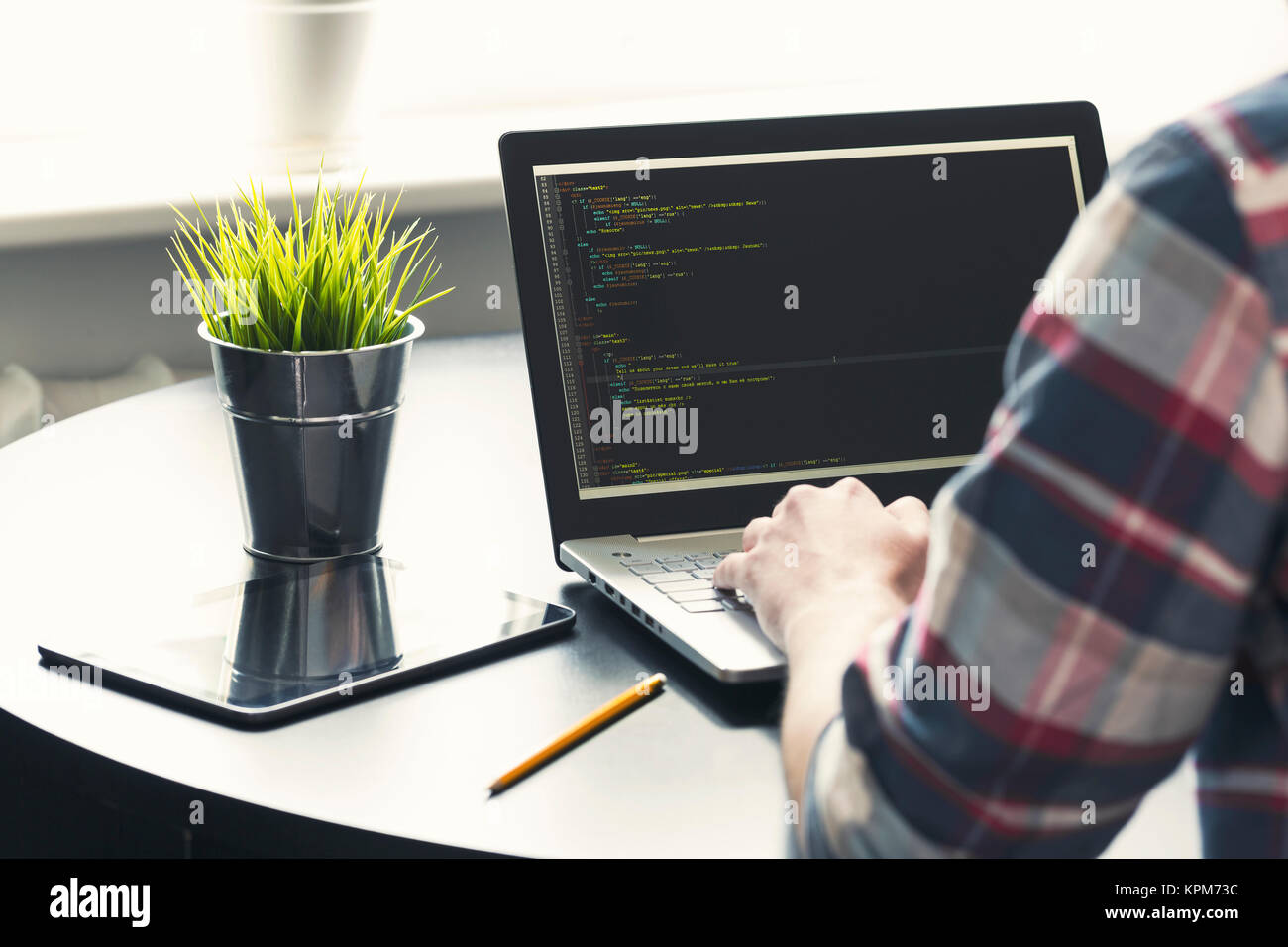 programmer working on laptop at office. focus on programming code Stock Photo