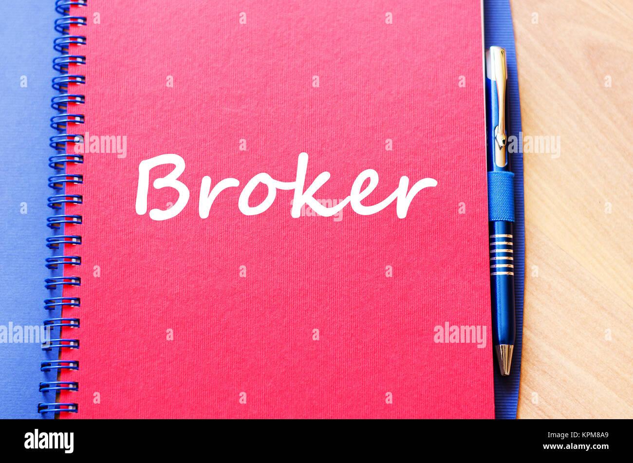 Broker write on notebook - Stock Image