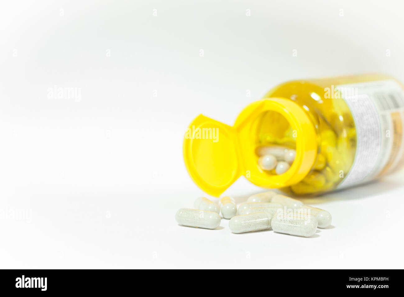 Close up capsules pill on white background - Stock Image
