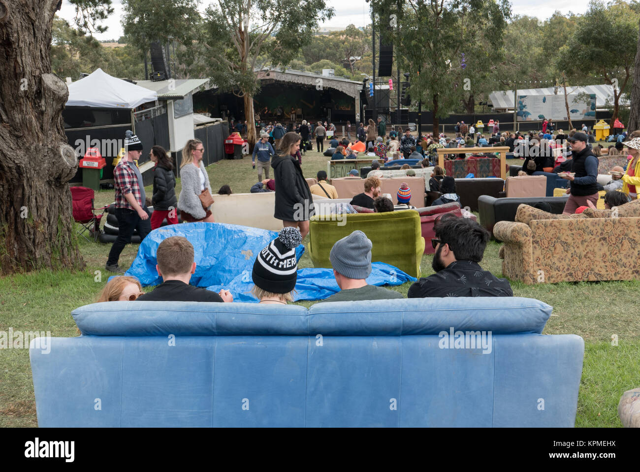 Young Australians sitting on couches they've decorated and brought to the Meredith Music Festival in Meredith - Stock Image