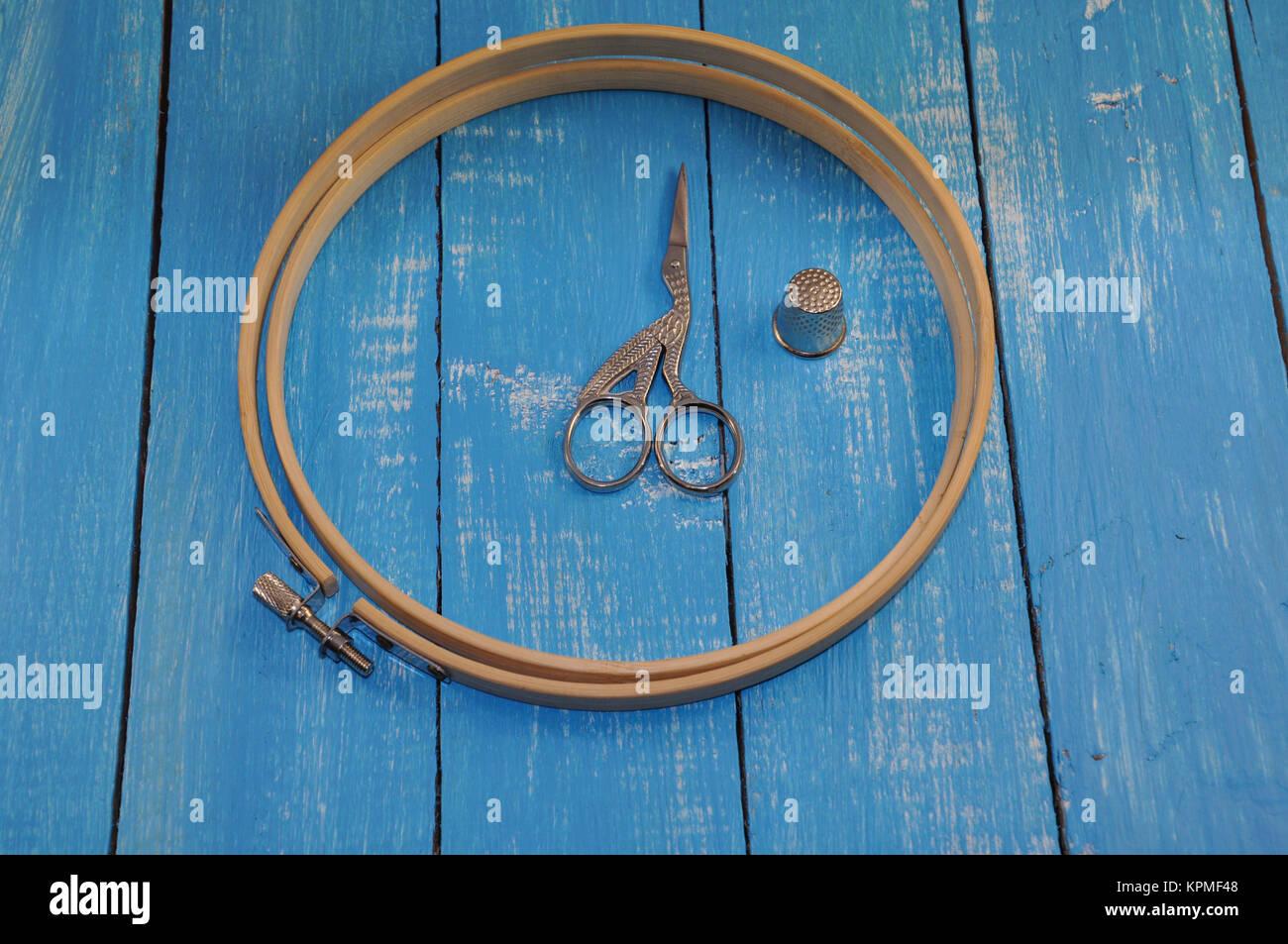Hoop, thimble, scissors for needlework - Stock Image