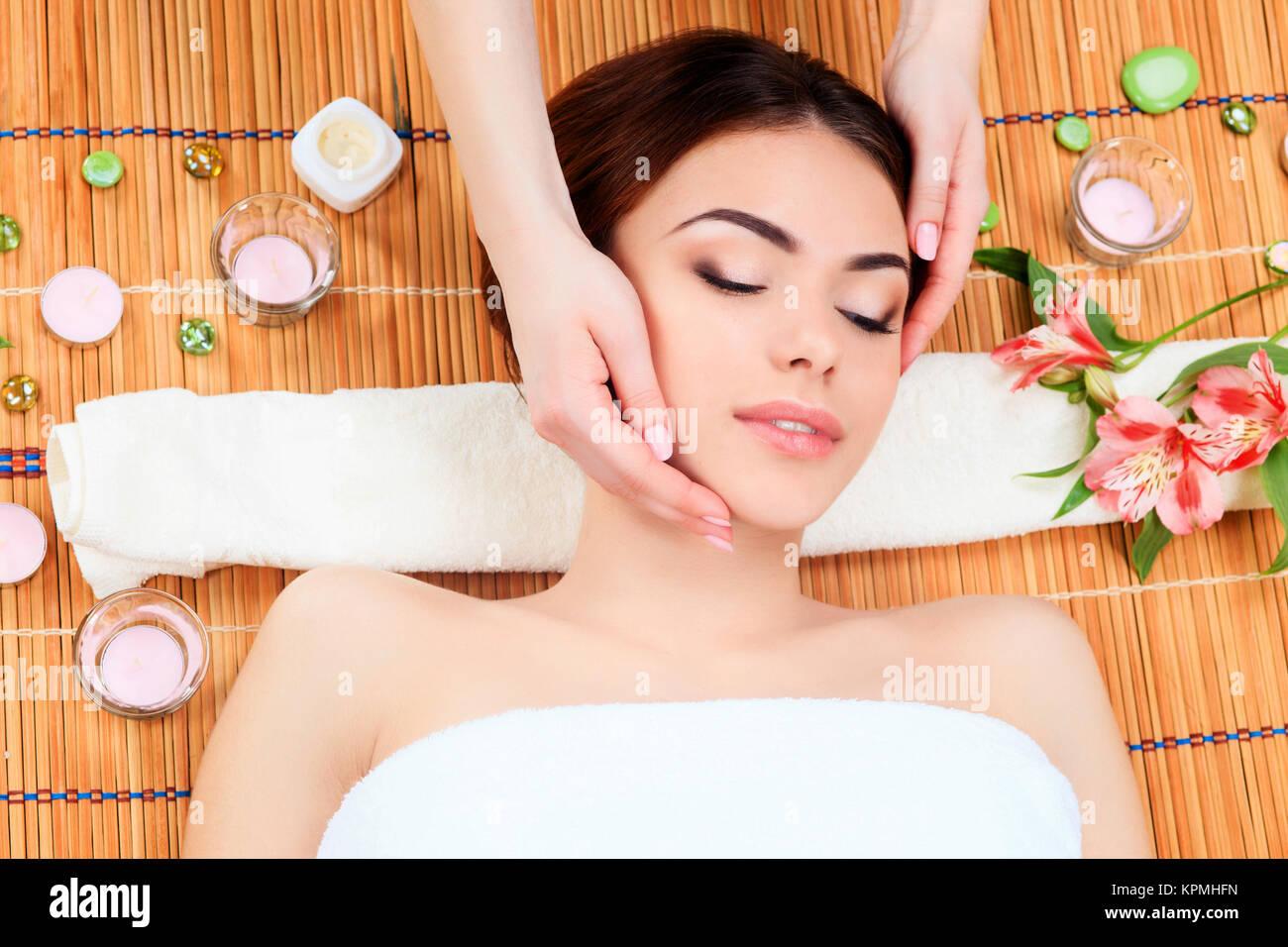 Beautiful young woman at a spa salon - Stock Image