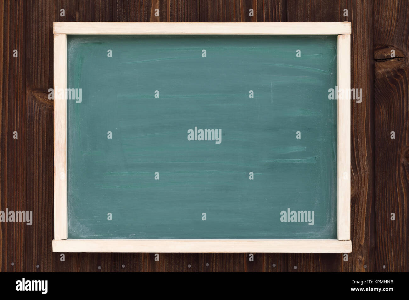 close up of vintage blackboard on a wood wall background - Stock Image