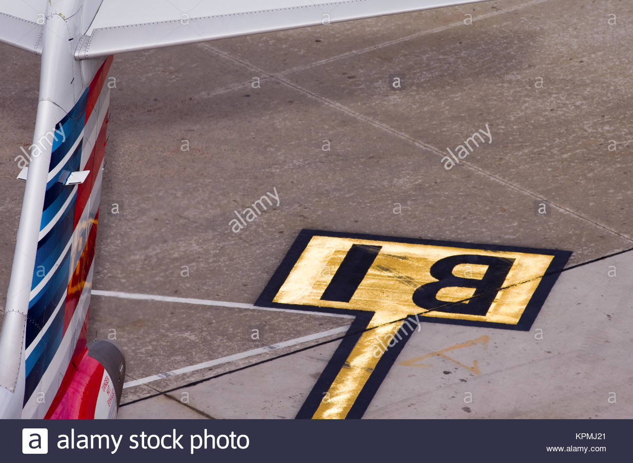 The tail of an airplane is visible in this abstract of an indication of location sign at Sky Harbor Airport in Phoenix, - Stock Image