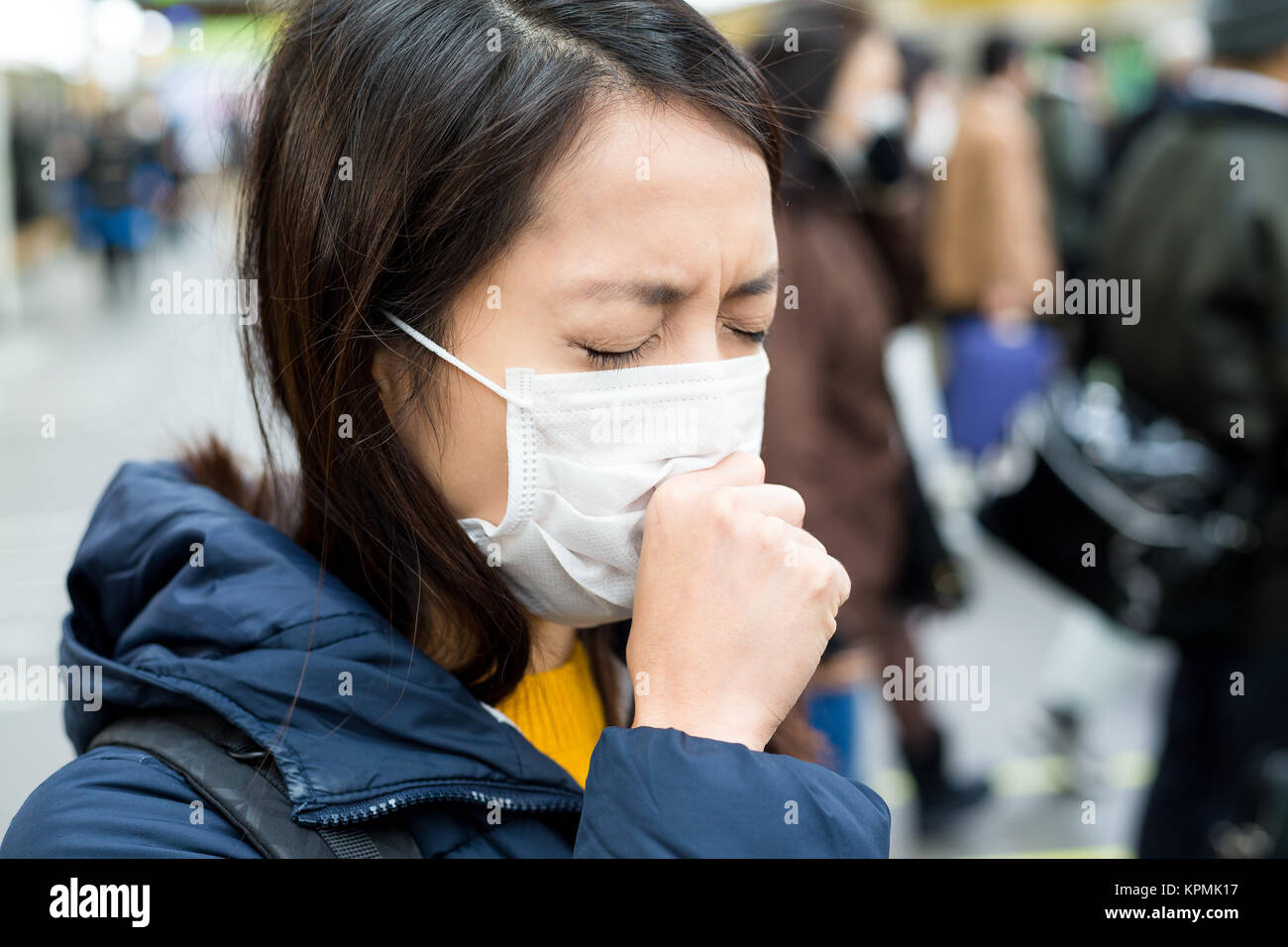 Woman suffer from sick in crowded of people - Stock Image