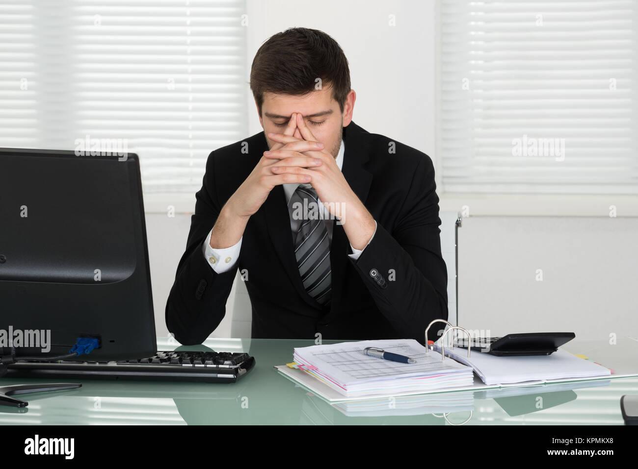 Stressed Businessman Calculating Bill - Stock Image