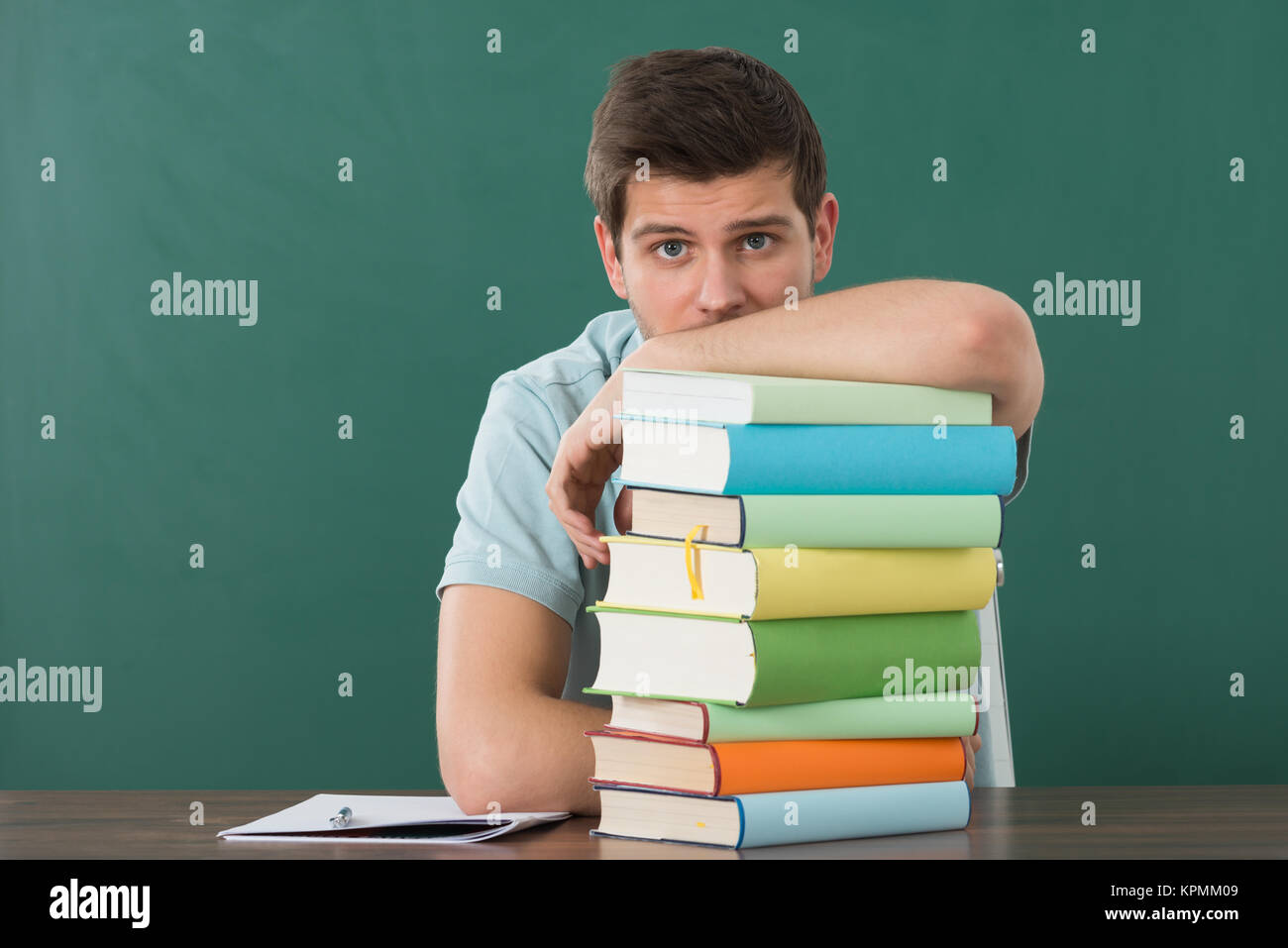 Man Leaning On Stack Of Books - Stock Image