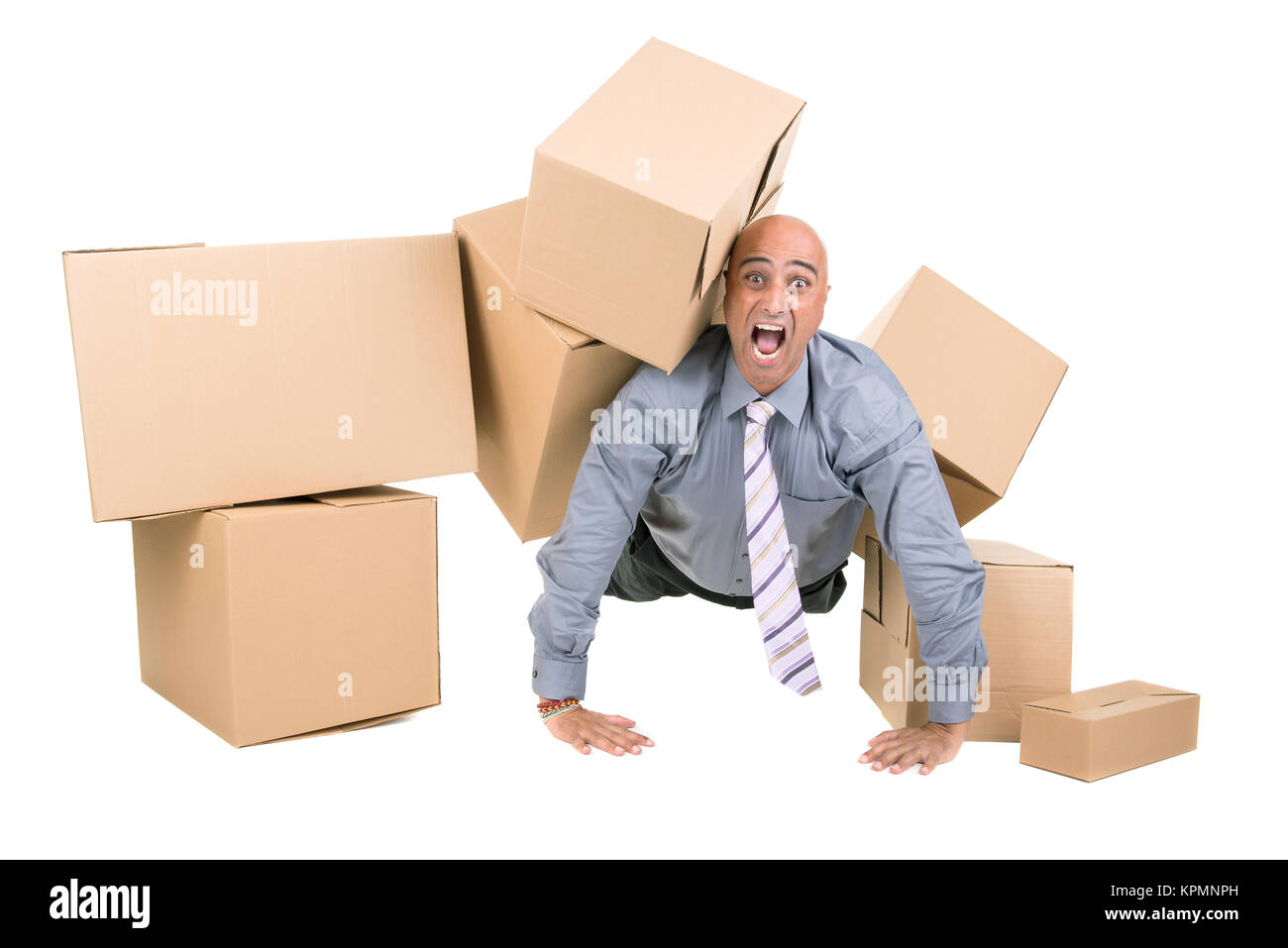 Businessman under boxes - Stock Image