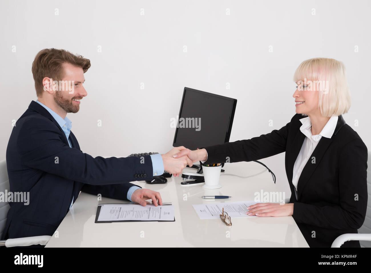 Businesspeople Shaking Hand - Stock Image