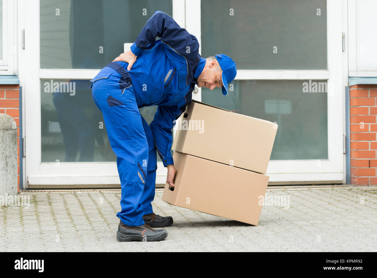 Delivery Man Suffering From Backpain - Stock Image
