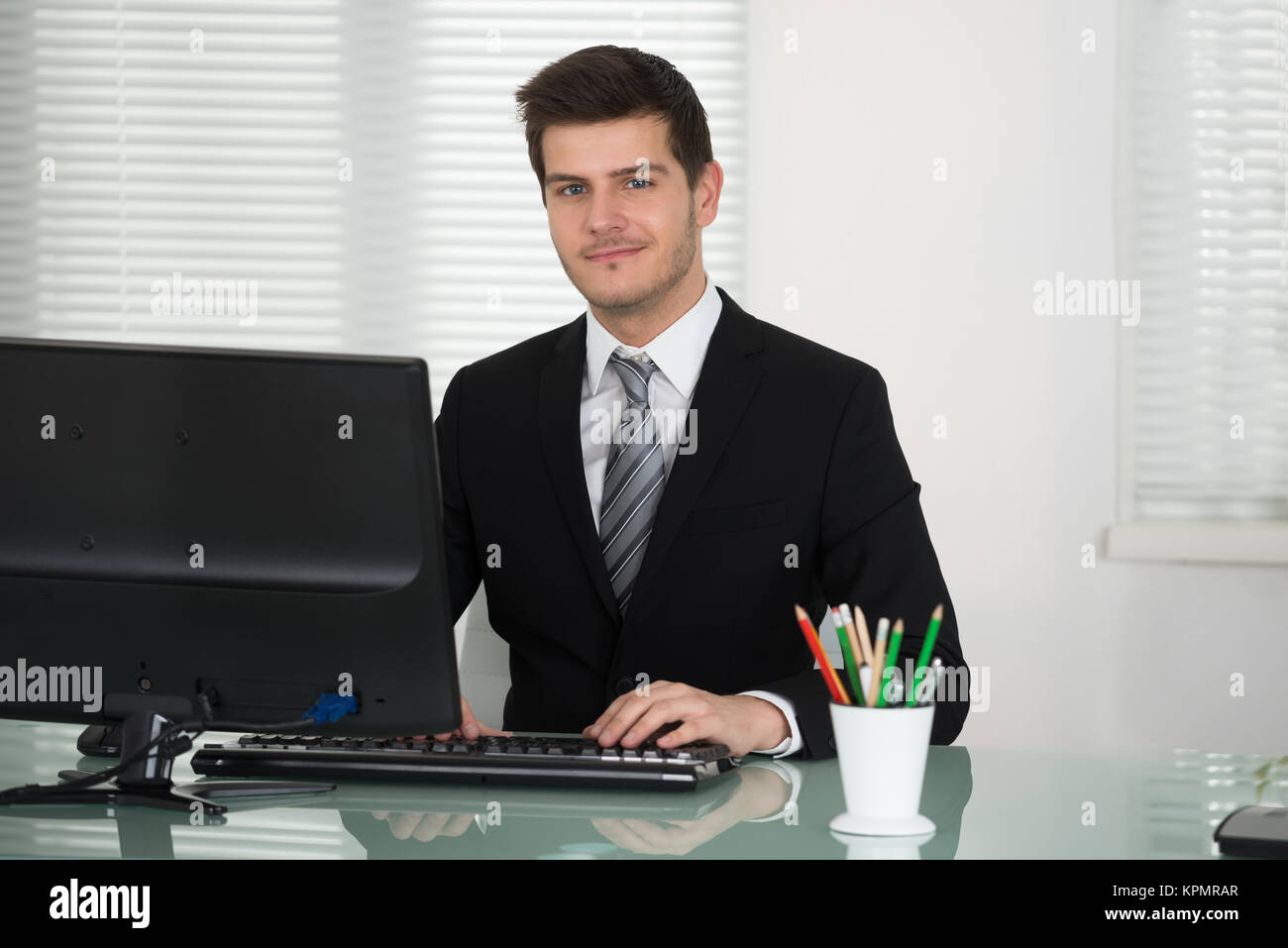 Businessman Working In Office - Stock Image