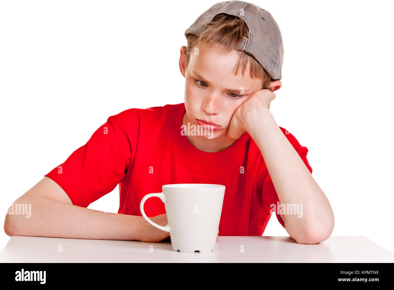 Bored child with white cup - Stock Image