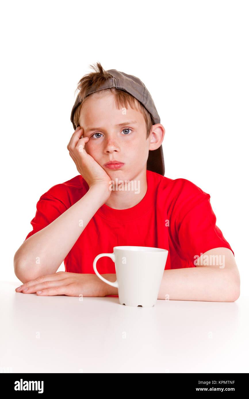 Depressed boy with white mug - Stock Image