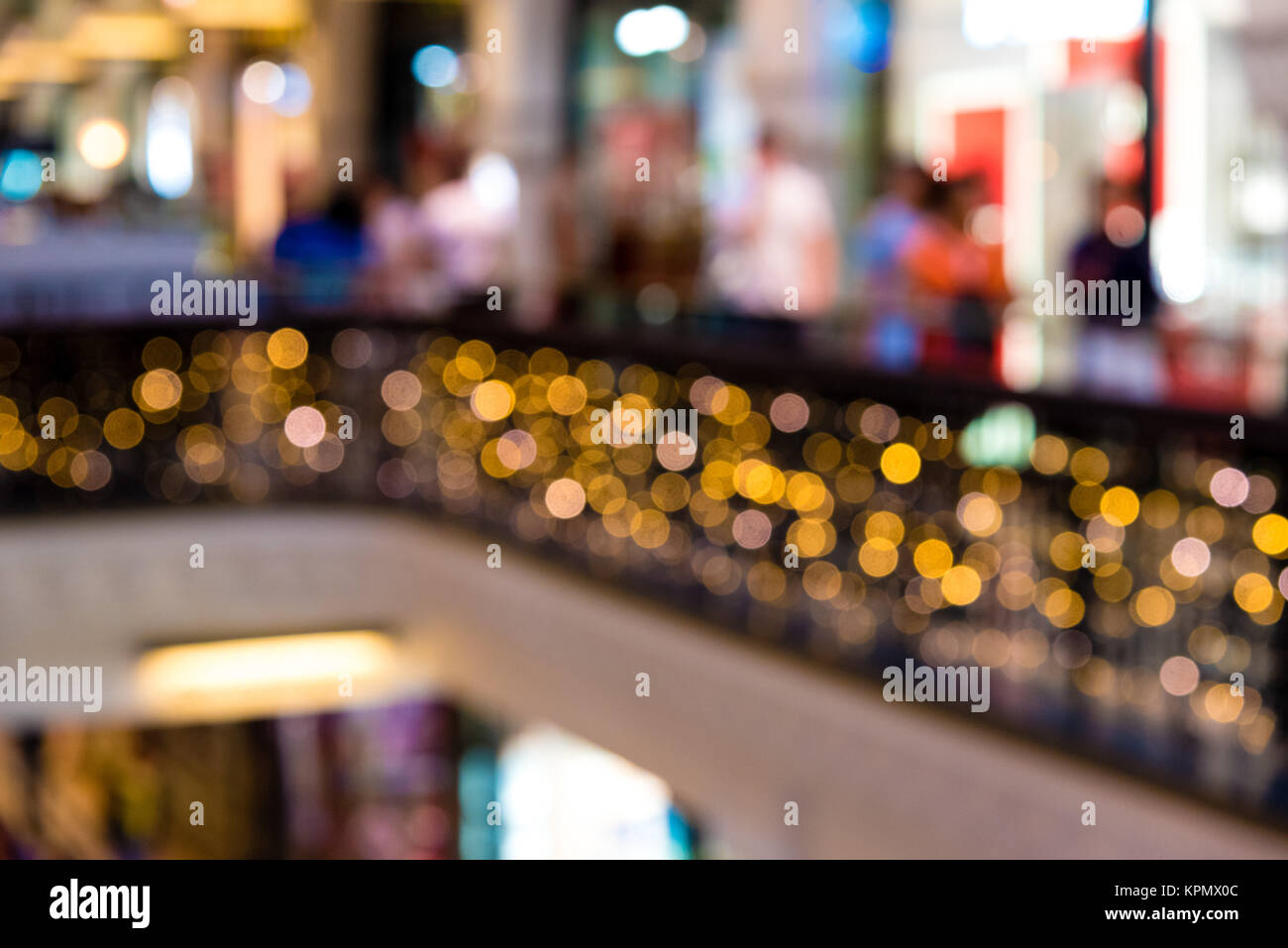 Blurred shopping mall background during winter holidays - Stock Image