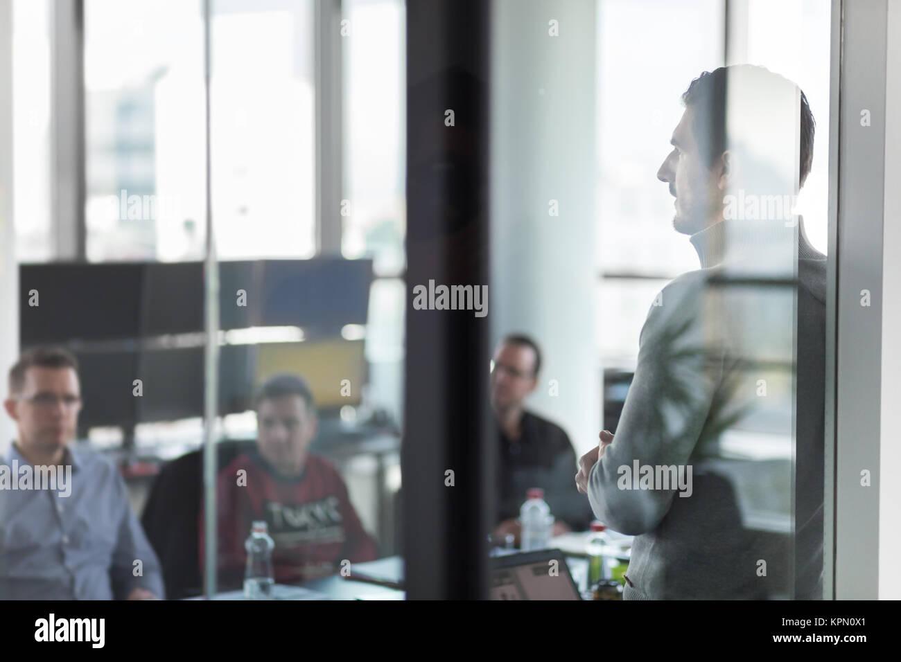 Business team leader delivering presentation in office. - Stock Image