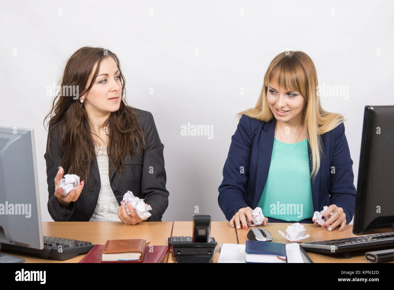 Angered, disgruntled employee office crumple the paper - Stock Image