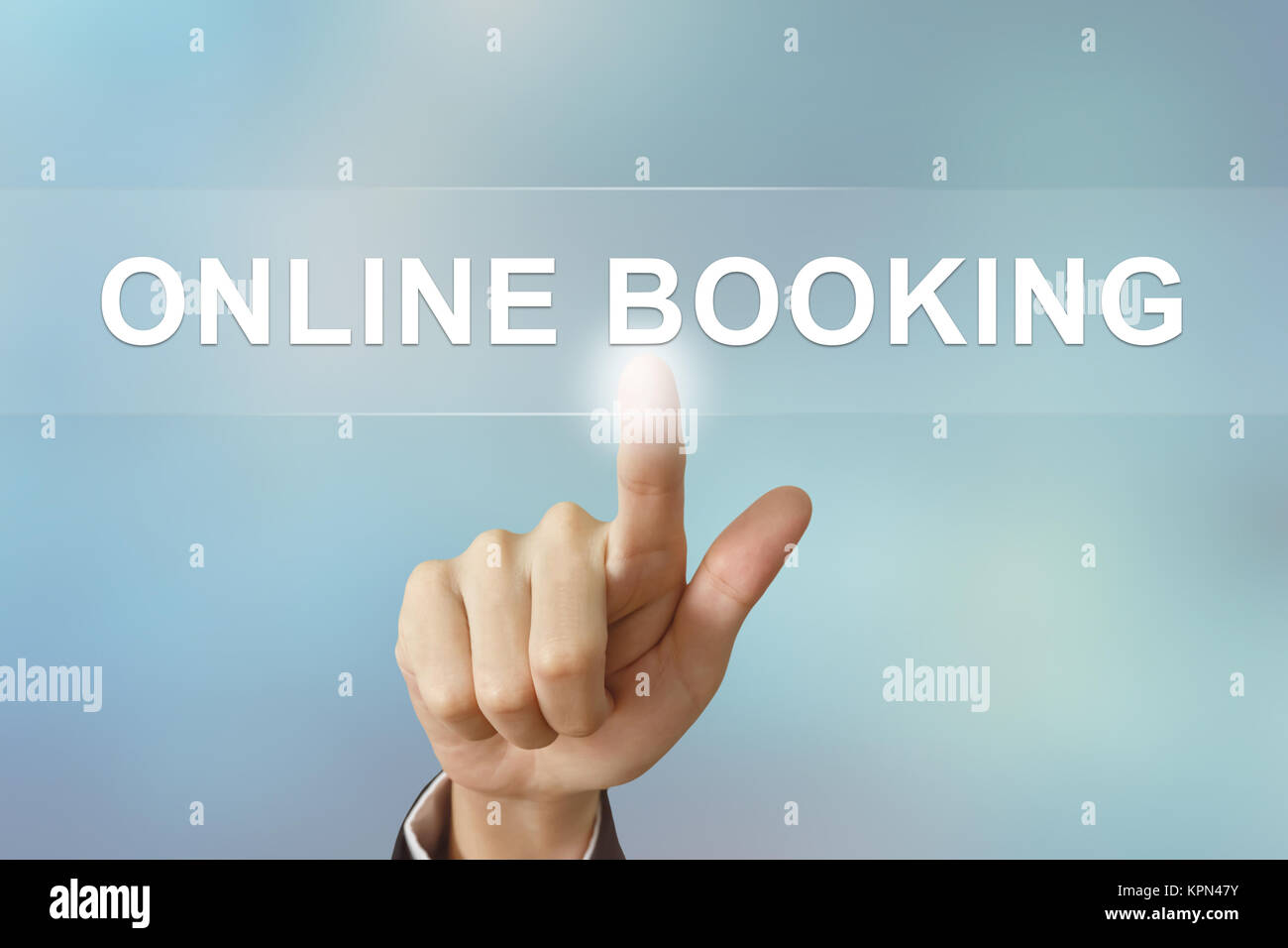 business hand clicking online booking button on blurred background - Stock Image