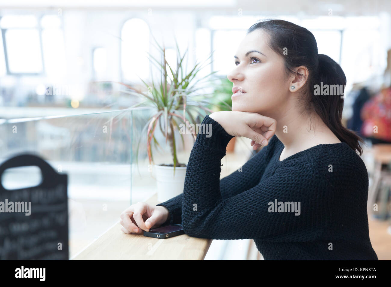 Day dreaming woman - Stock Image