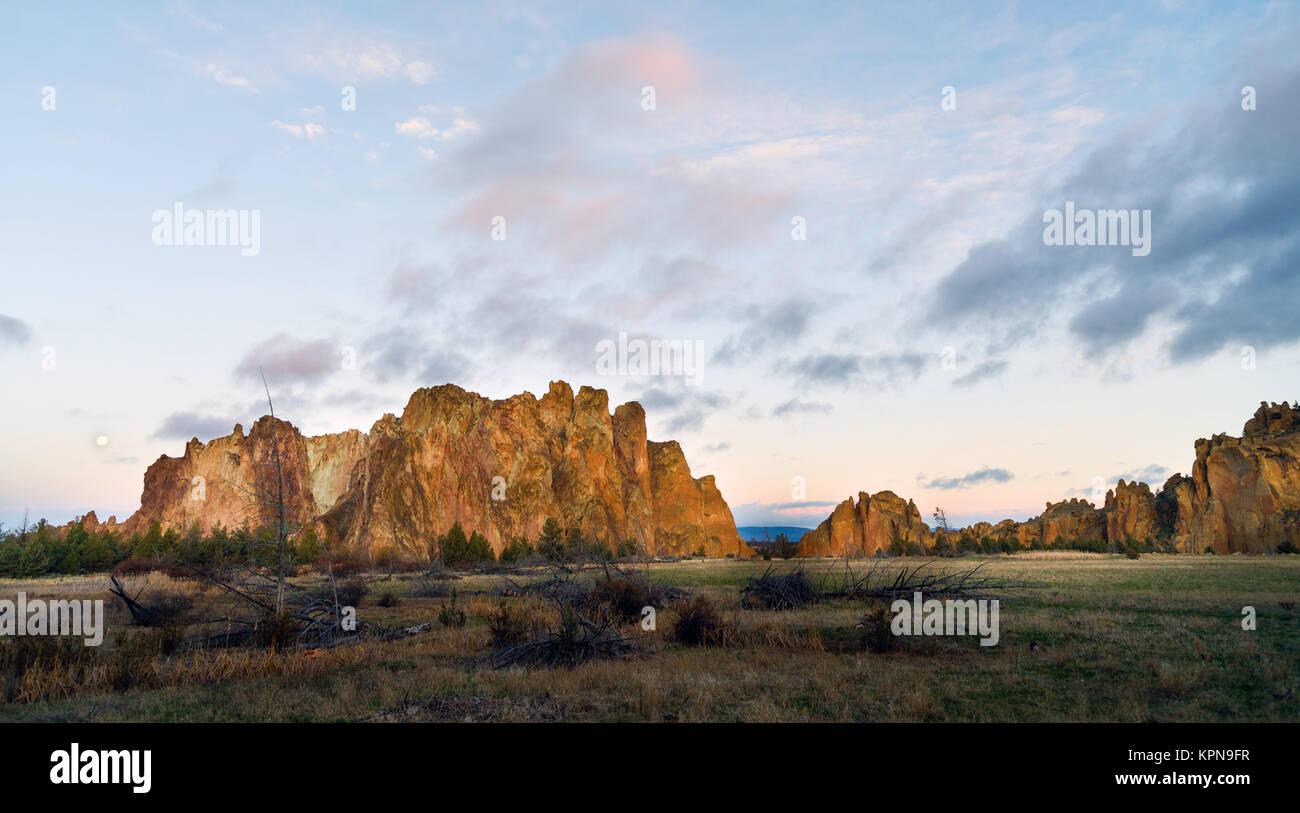 The Moon Sets as Sun Rises on Smith Rock Oregon Stock Photo