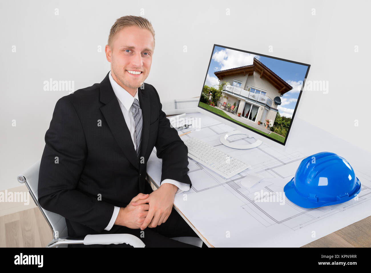 happy architect smiling at work stock photo 168884459 alamy