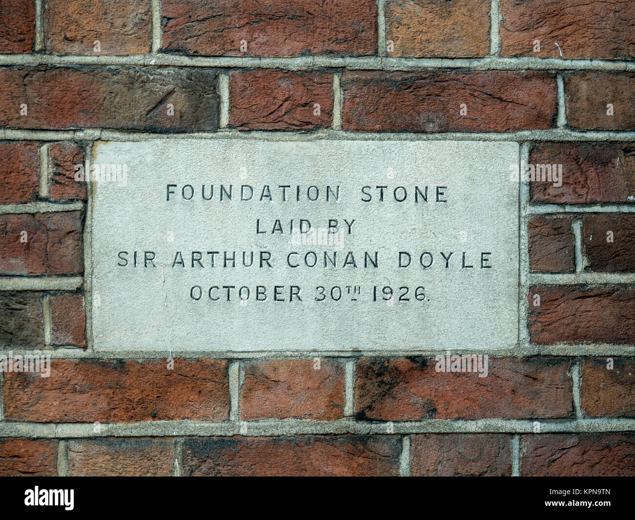 Foundation stone of the Camden Spiritualist Church laid by Sir Arthur Conan Doyle in 1926, in Rochester Square, - Stock Image