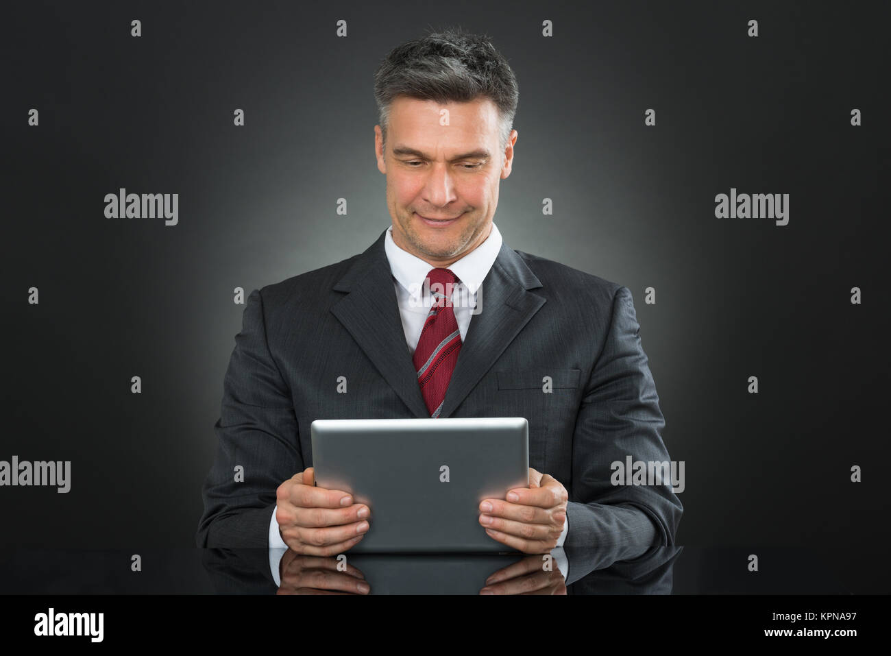Businessman Using Digital Tablet - Stock Image