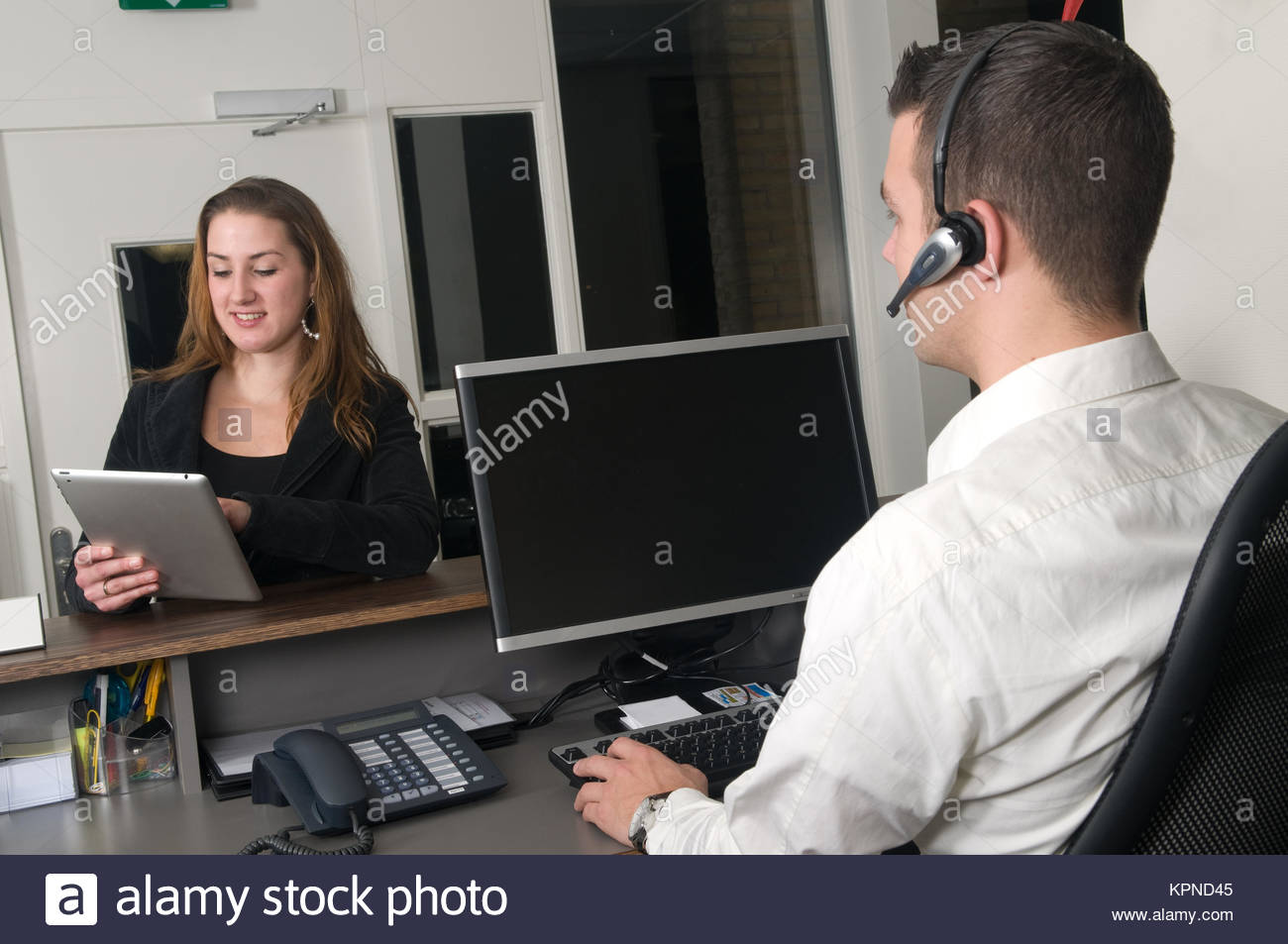 Customer at a service desk - Stock Image