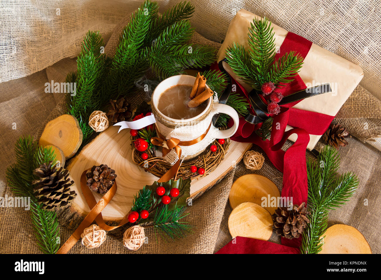 New Year's still life with a cup of coffee, a gift box and pine branches - Stock Image