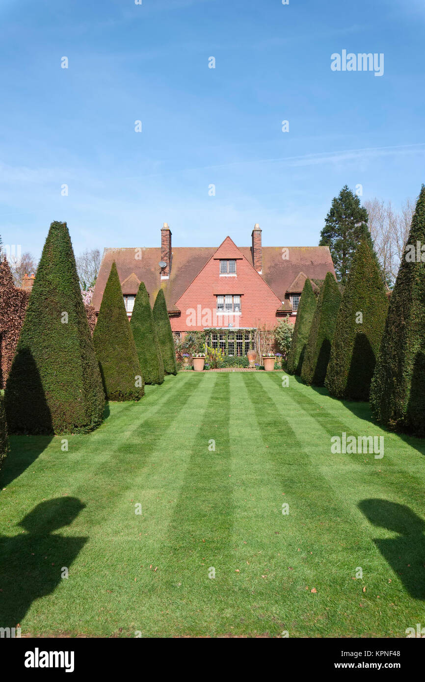 Striped Lawn and Clipped Yews The Old Vicarage Arts and Crafts House at East Ruston Norfolk - Stock Image
