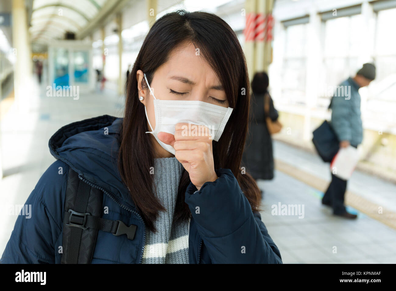 Woman suffer from sick with wearing face mask - Stock Image