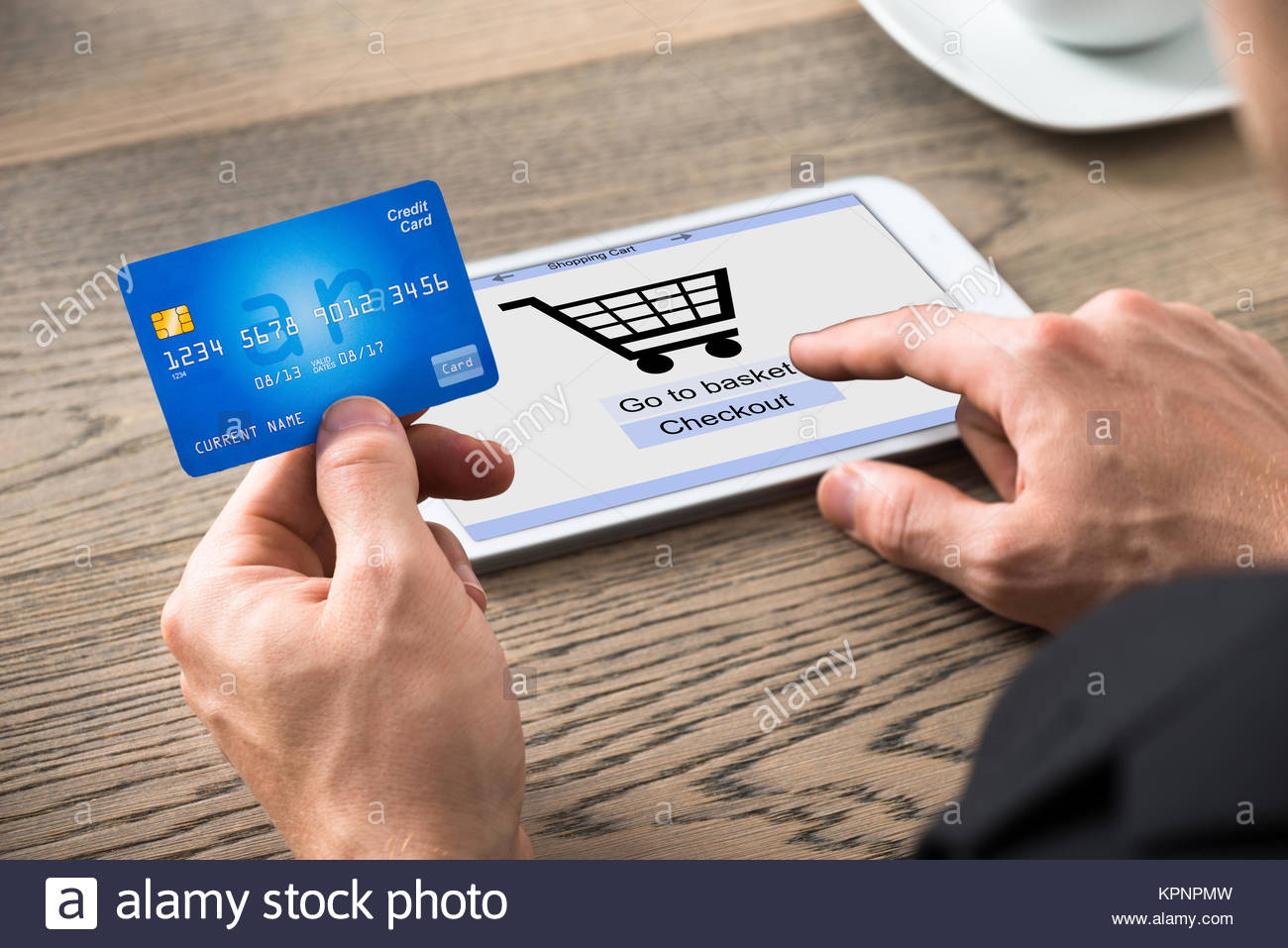 Close-up Of Businessman Shopping Online Stock Photo
