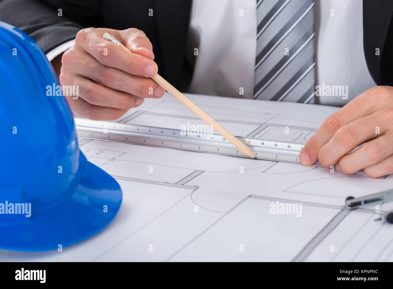 Architecture blueprint blue pencil on stock photos architecture male architect hand using pencil and ruler on blueprint stock image malvernweather Gallery