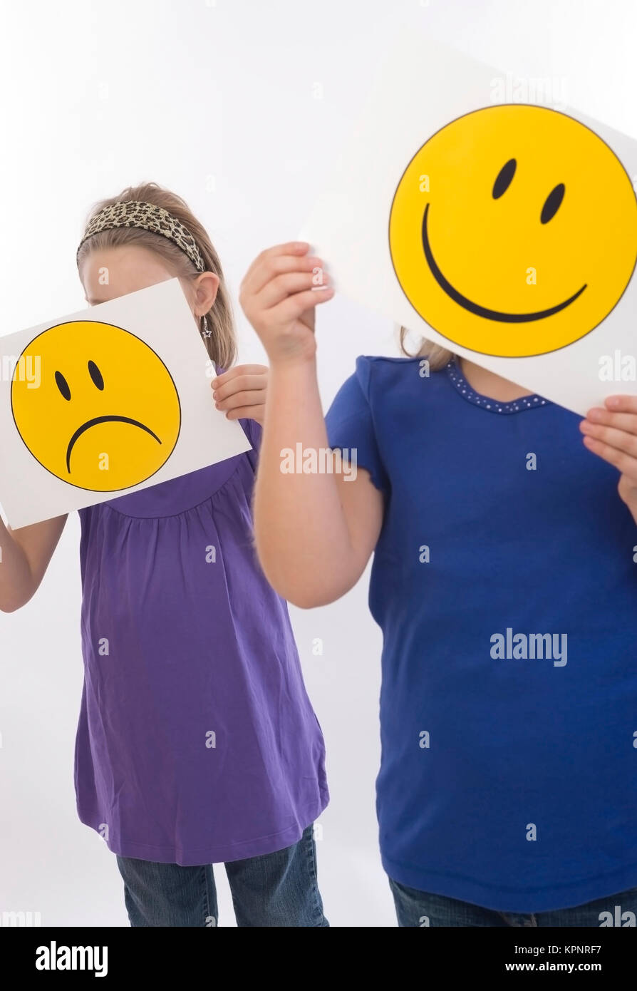 Model release , Trauriges und froehliches Kind, Symbolbild - sad an happy children, symbolic Stock Photo