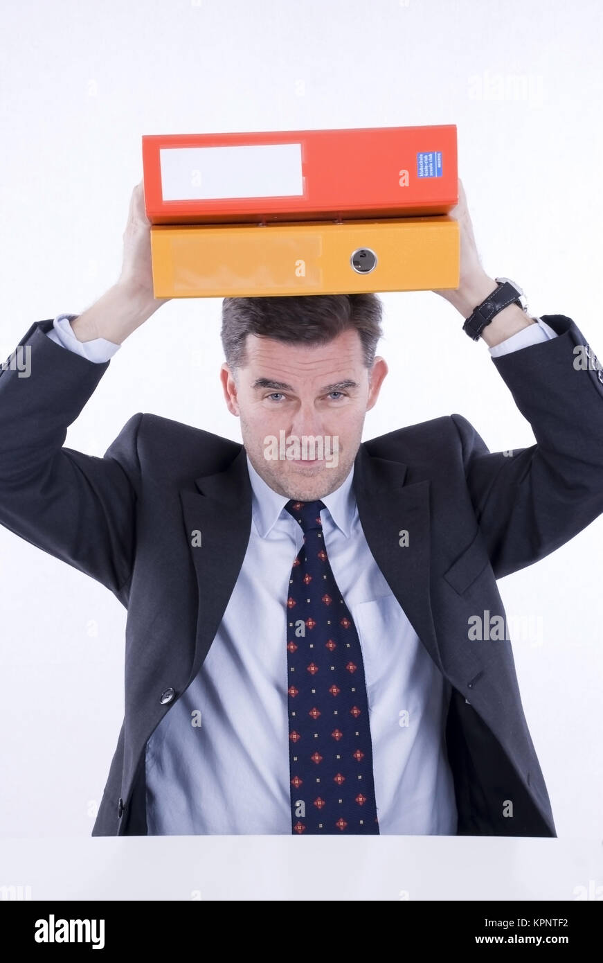 Model release , Geschaeftsmann mit Akten am Kopf - business man with files on head - Stock Image