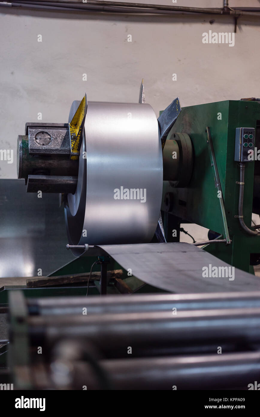 close-up of roll of metal sheet - Stock Image