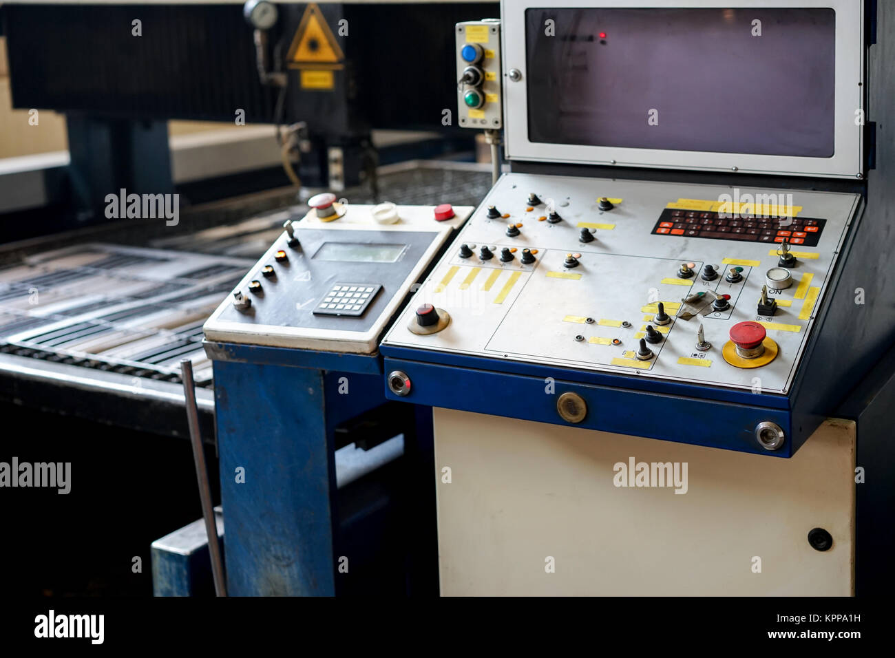 control panel of a laser cutting machinery - Stock Image