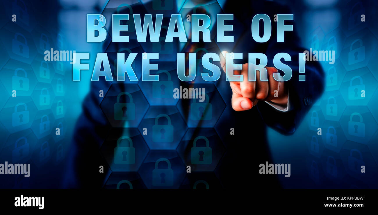 Corporate Manager Pushing BEWARE OF FAKE USERS! - Stock Image