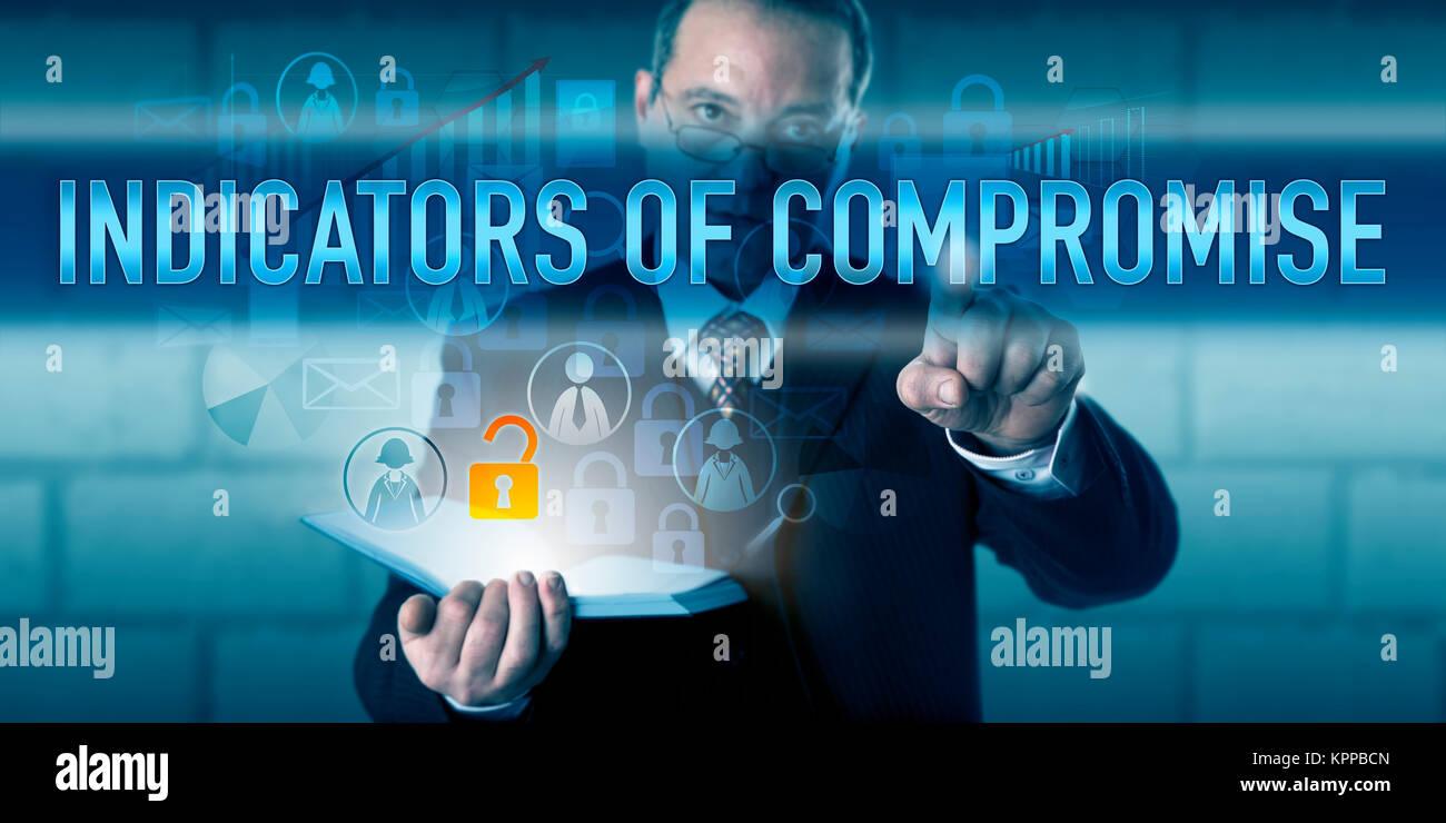 Forensic Expert Pushing INDICATORS OF COMPROMISE - Stock Image