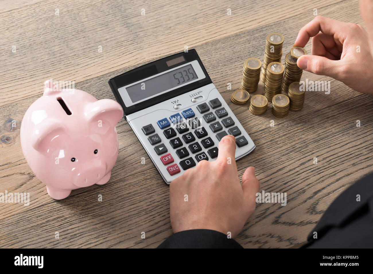 Close-up Of A Businessman Counting Coins - Stock Image