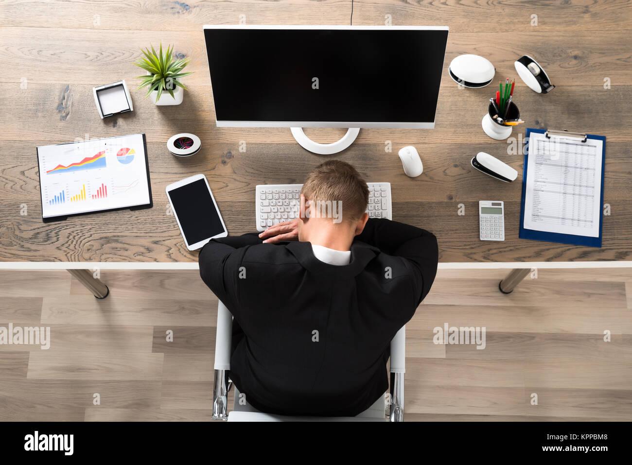Businessman Sleeping In Office - Stock Image