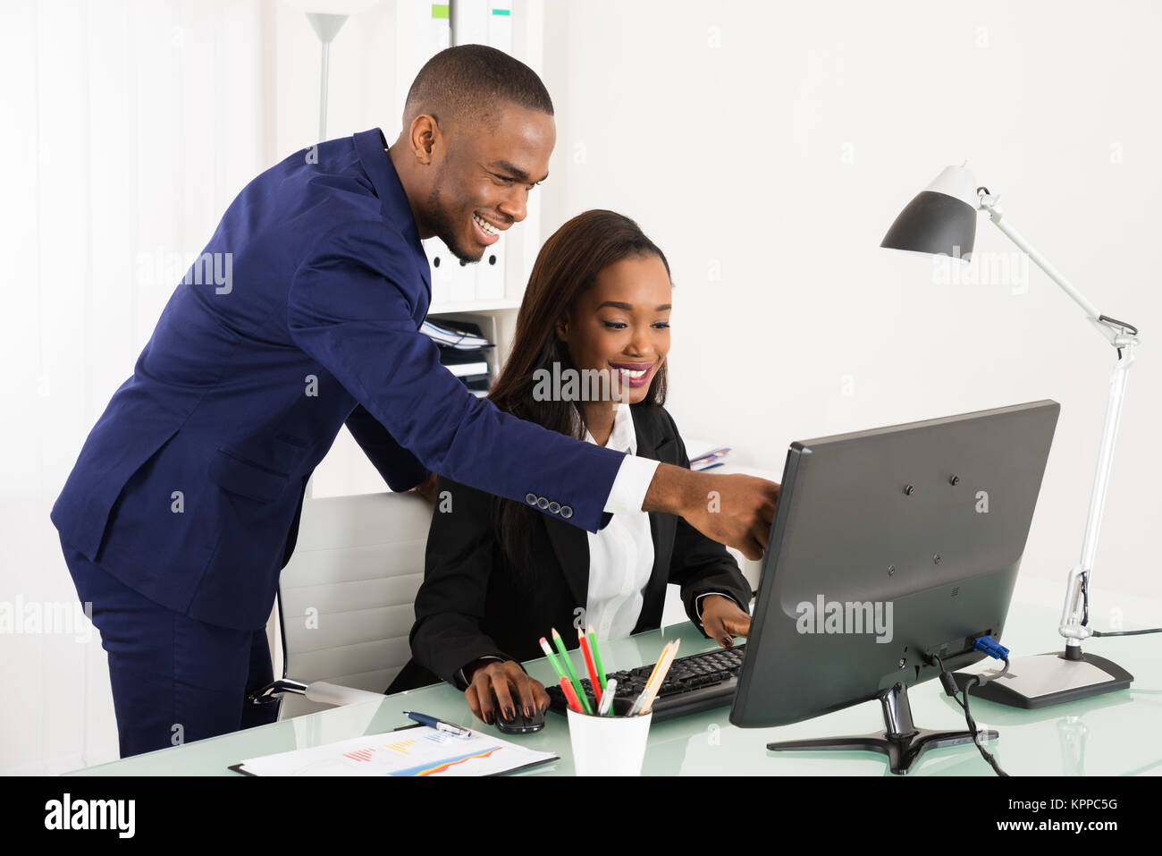 Businesspeople Working On Computer In Office - Stock Image